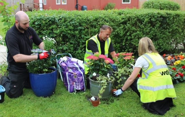 Green fingered volunteers from WDH give The Prince of Wales Hospice a helping hand.